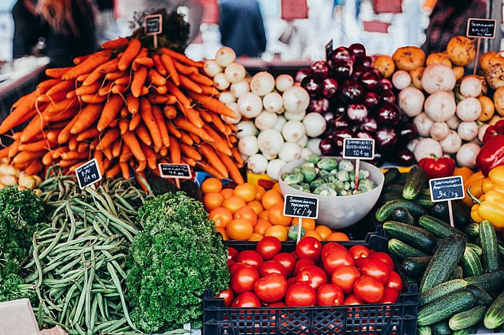 A market display of fresh fruit and vegetables.